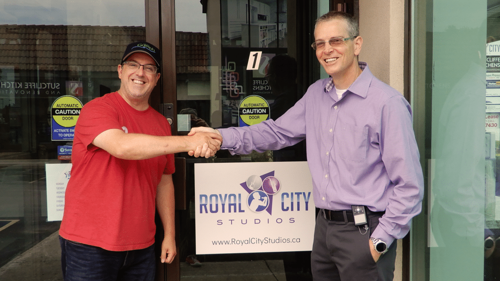 Royal City Studios owner Jim Duffield welcomes Guelph Mayor Cam Guthrie to Royal City Studios.