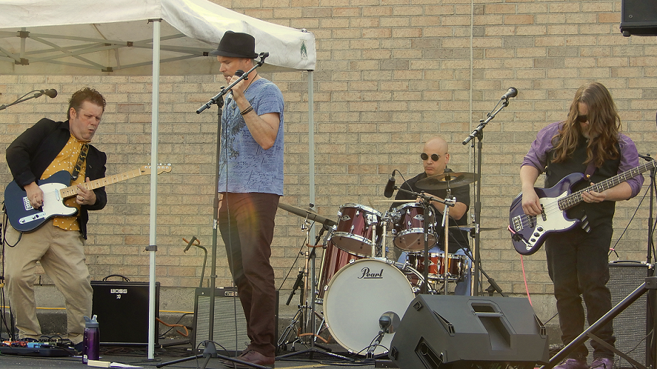 Buzz Kings perform at Royal City Studios' inaugural Classic Covers Cool Cars concert event.