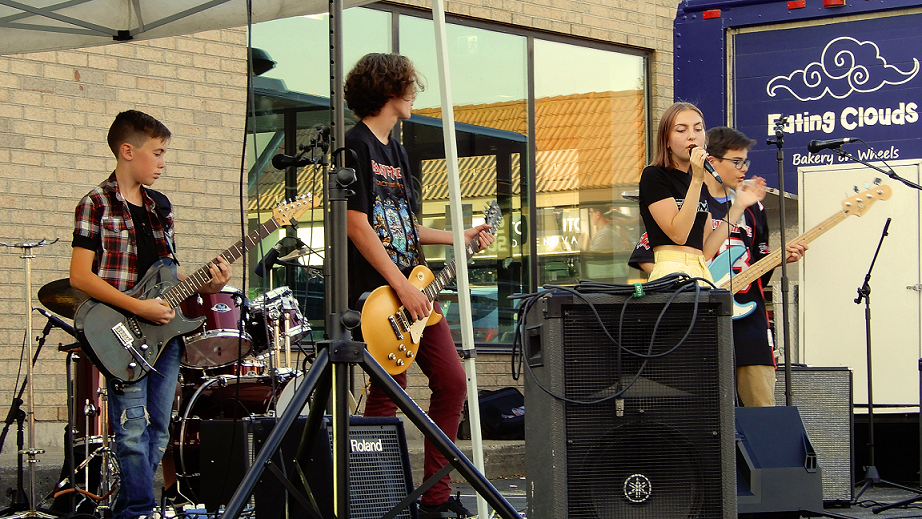 The Bend performs at Royal City Studios' inaugural Classic Covers Cool Cars concert event.