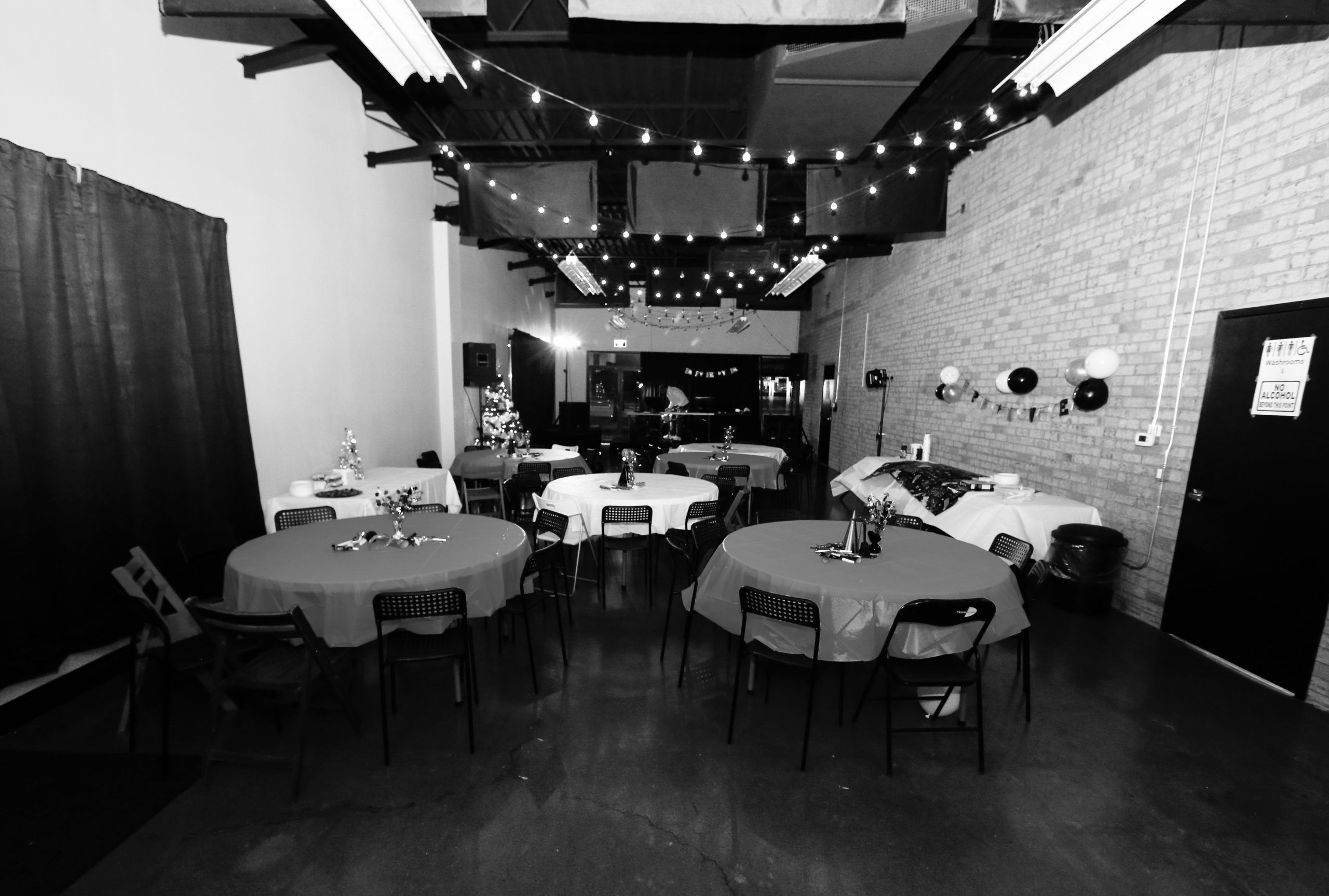Black and white event hall dinner setup